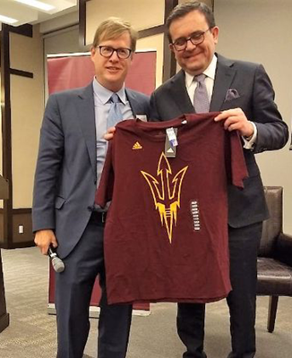 Two men holding an ASU t-shirt